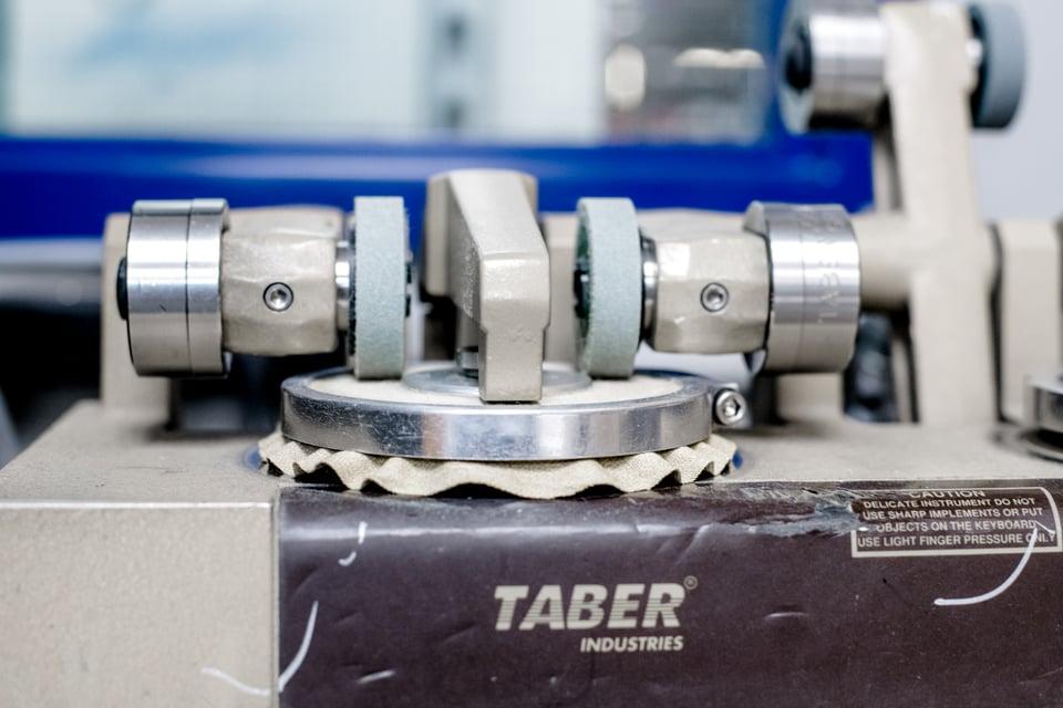 Taber Machine.